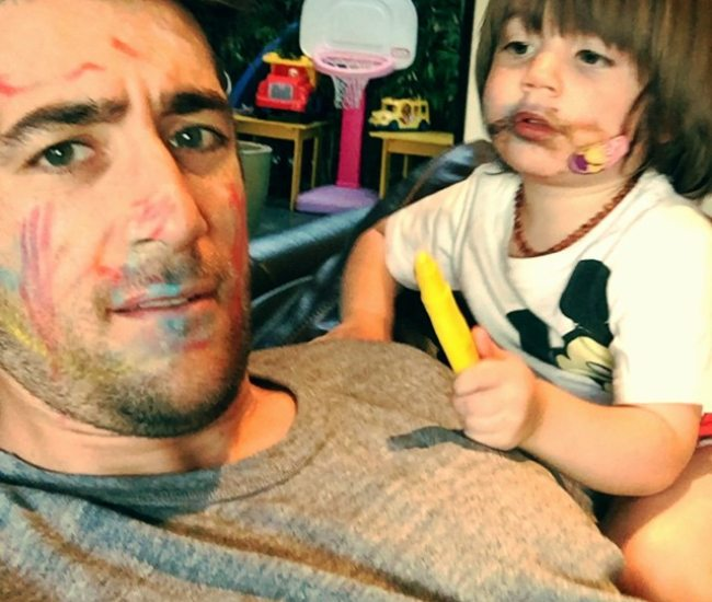 Jonathan Togo with his son as seen in March 2015