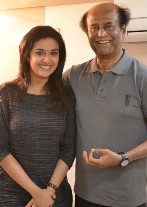 Keerthy Suresh as seen in a picture with legendary actor Rajinikanth in December 2018