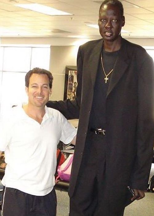 Manute Bol (Right) with comedian Dave Burleigh