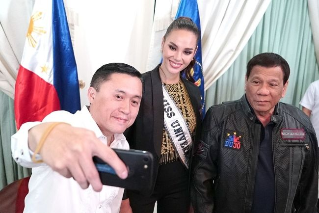 Miss Universe 2018 Catriona Gray appearing with President Rodrigo Duterte and politician Bong Go at the Villamor Air Base in Pasay in December 2018