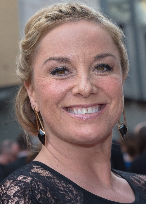 Tamzin Outhwaite as seen while smiling for the camera at the Oliver Awards 2015