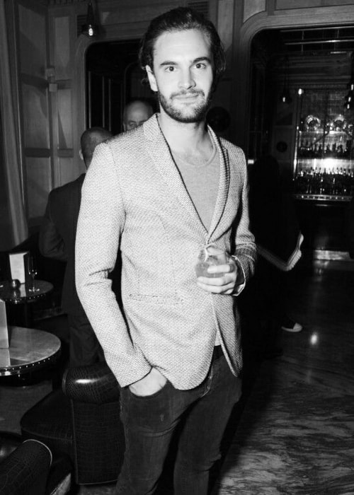 Tom Bateman as seen in a black-and-white picture during an event