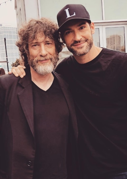 Tom Ellis (Right) as seen while posing for a picture with author Neil Gaiman at the San Diego Comic-Con in San Diego, California in July 2018