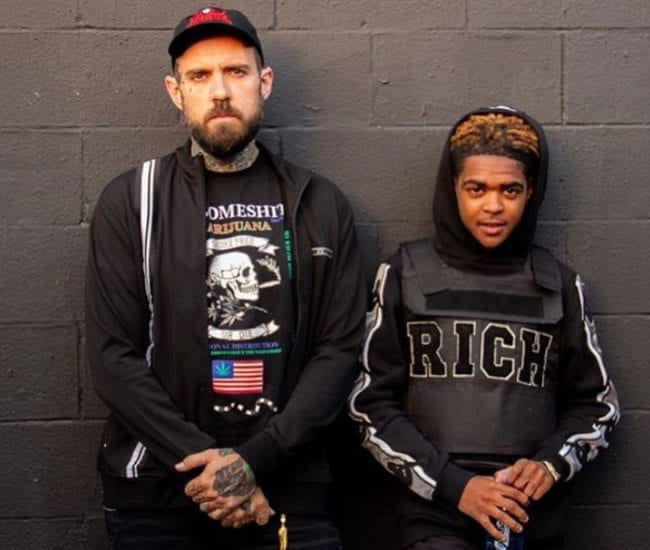 YNW JGreen (Right) and Adam22 as seen in May 2019