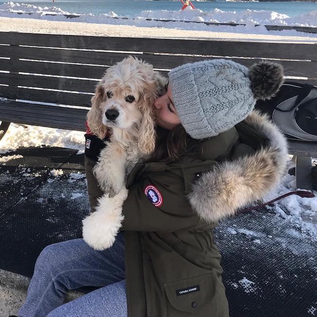 Alex Hook kissing her dog in December 2017