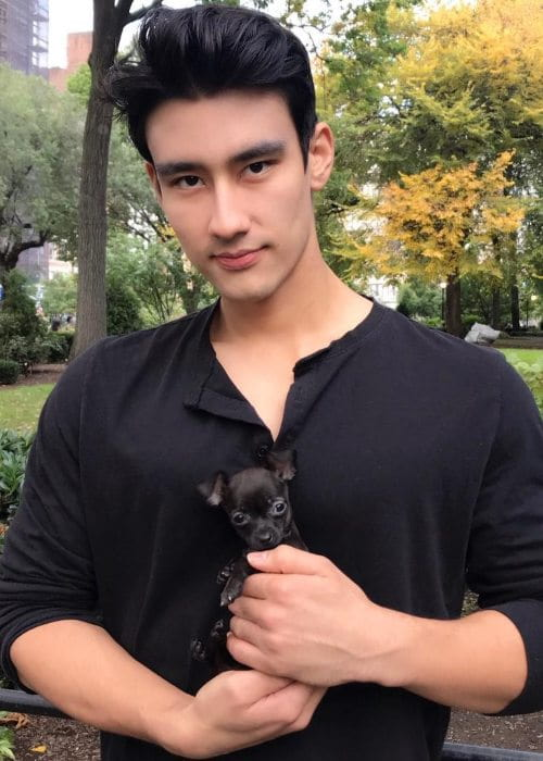 Alex Landi with his dog as seen in October 2018