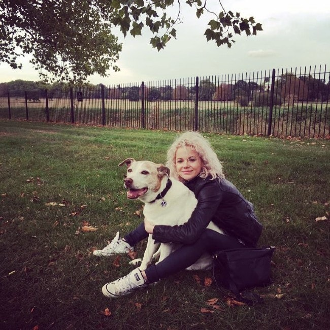 Amy Lennox with her dog as seen in September 2018