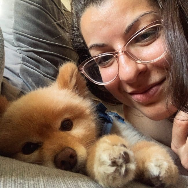 Anita Sarkeesian in a selfie with her dog as seen in June 2019
