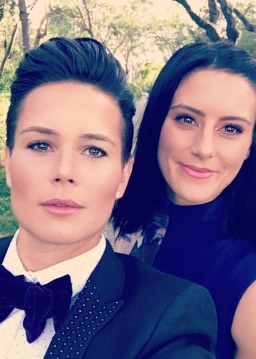 Ashlyn Harris with her girlfriend as seen in December 2017