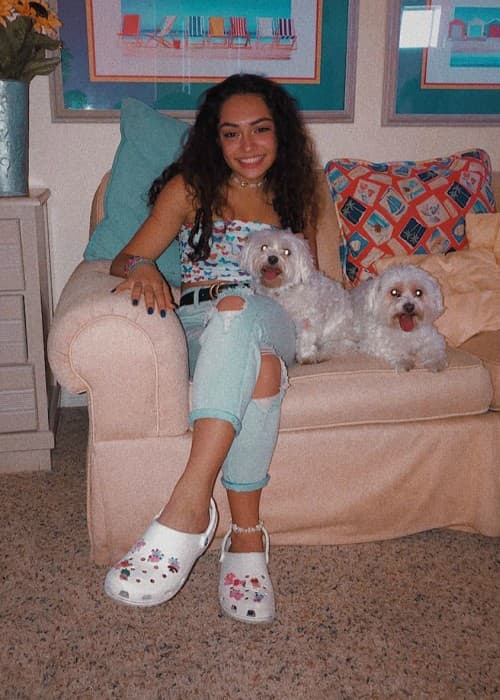 Avani Gregg with her dogs as seen in July 2019