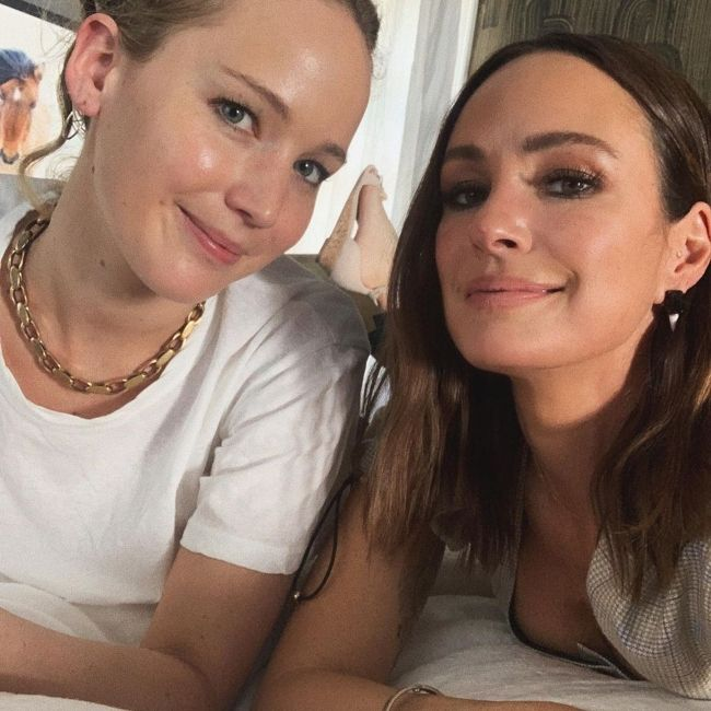 Catt Sadler posing with actress Jennifer Lawrence during her Naked podcast interview