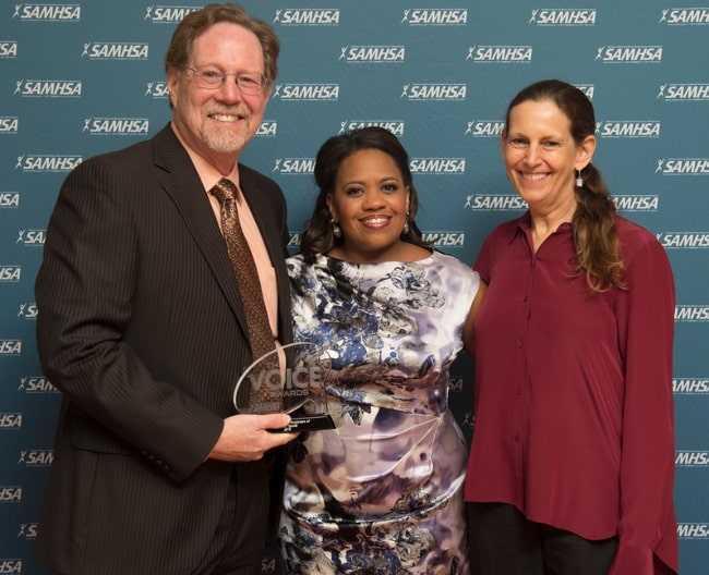 Chandra Wilson (Center) posing backstage alongside the director and writers of the documentary, Mind-Game, Rick Goldsmith & Sharon Wood, after being collectively honored with a 2015 Voice Award
