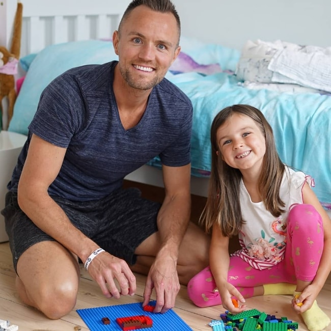 Darren Fizz as seen while posing for the camera with his daughter as they both spend some LEGO-time in November 2018