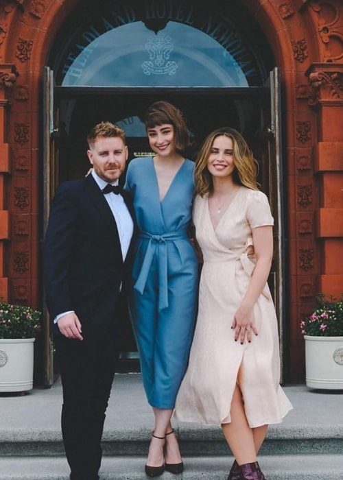 Heida Reed as seen while posing for a picture with Ellise Chappell (Center) and Christian Brassington at The Headland Hotel and Spa in June 2019