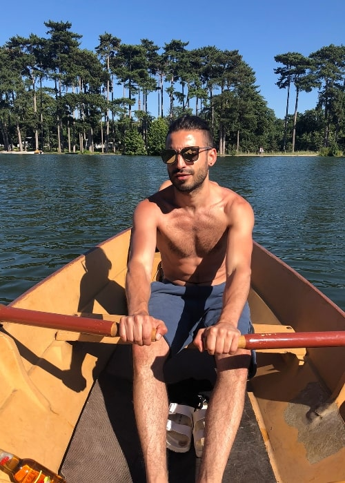 Jade Hassouné as seen shirtless while rowing a boat in Lac du Bois de Boulogne in June 2018