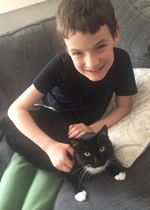 Jason Maybaum with his cat as seen in April 2019