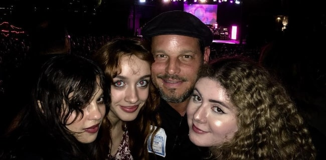 Justin Chambers as seen while posing for a picture alongside his daughter's band, PINKY PINKY, as they opened for The B-52's in San Diego, California, United States in October 2018
