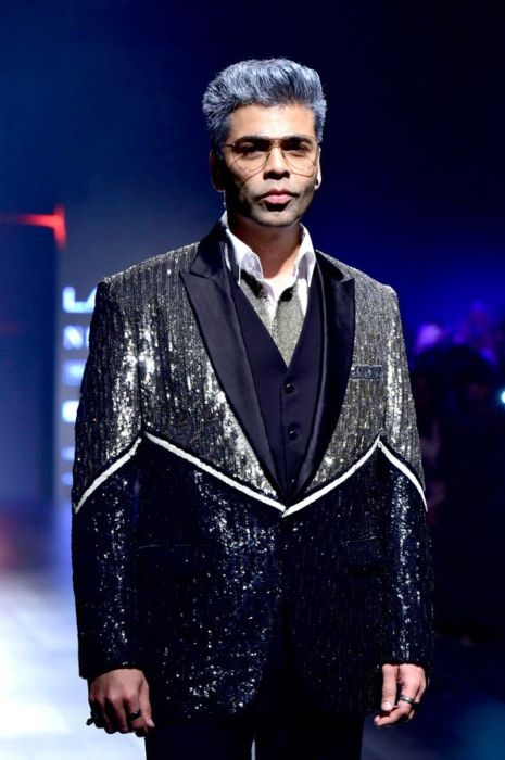 Karan Johar walks the ramp for Shane and Falguni Peacock in February 2018