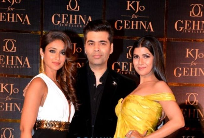 Karan as seen with Ileana D'Cruz and Nimrat Kaur at the unveiling of his Jewelry line KJo for Gehna