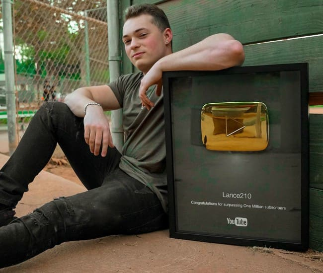 Lance Stewart in an Instagram post with his Golden YouTube Play Button in October 2017