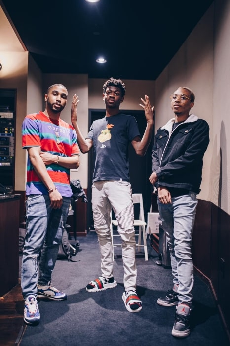 Lil Nas X as seen while posing for the camera with BiznessBoi (Left) and Boyband (Right) in the studio in April 2019