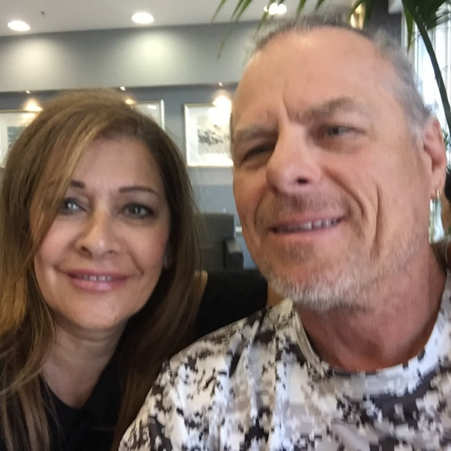 Marina Sirtis as seen in a picture wuth her husband Michael Lamper at the Athens airport in August 2018