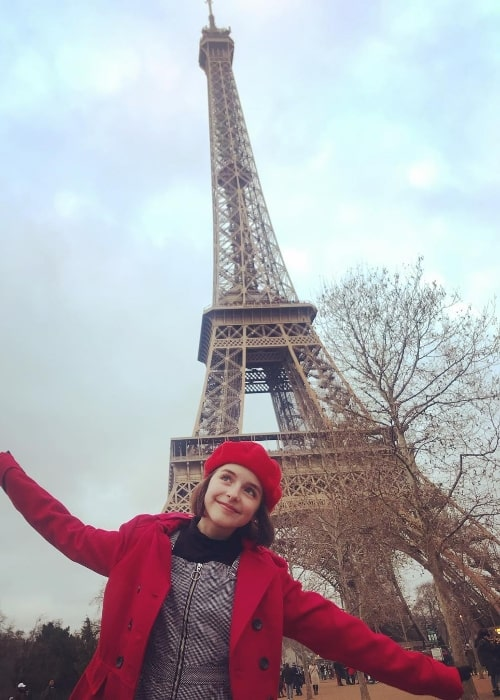 Mckenna Grace as seen while posing for a picture with the backdrop of Eiffel Tower in Paris, France in December 2018