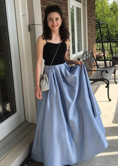 Olivia Presti as seen while posing for the camera while wearing a beautiful dress for her grade 8 graduation in June 2019