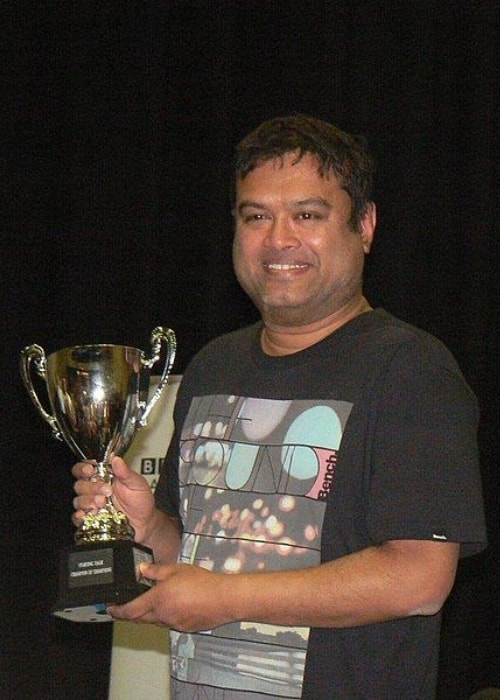 Paul Sinha as seen in May 2015 with the Fighting Talk Champion of Champions Trophy