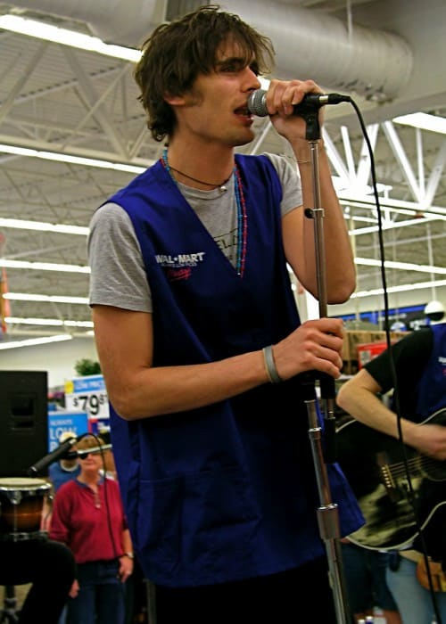 Tyson Ritter performing an acoustic set at Walmart in Houston in March 2006