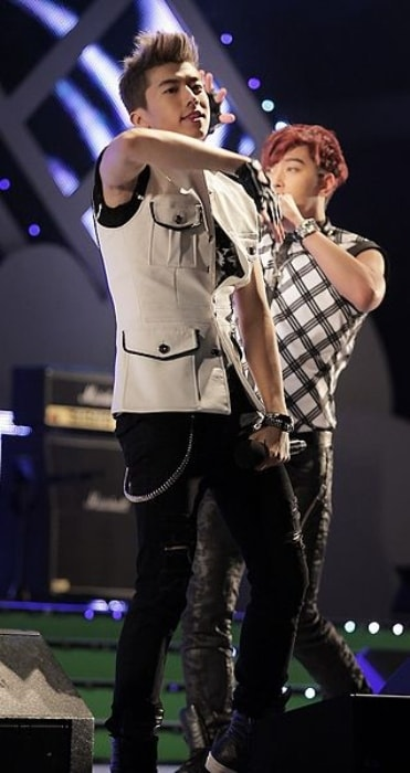 Wooyoung as seen performing in July 2011