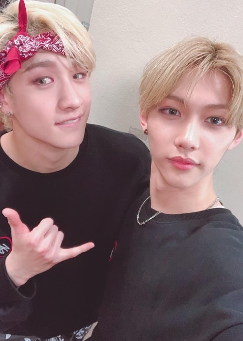 Bang Chan (Left) as seen while posing for a selfie along with his 'Stray Kids' bandmate, Felix, in April 2019