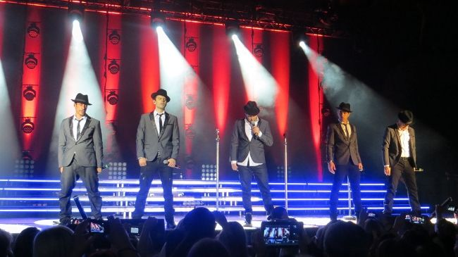 Danny Wood, Jordan Knight, Donnie Wahlberg, Joey McIntyre, and Jonathan Knight performing at the European Tour in 2014