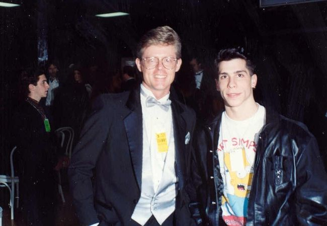 Danny Wood posing with Alan Light backstage during the 1990 Grammy Awards