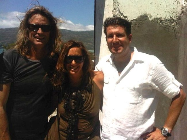 Donna Karan posing with businessman Michael Capponi (r) and photographer Russell James (l) in Haiti
