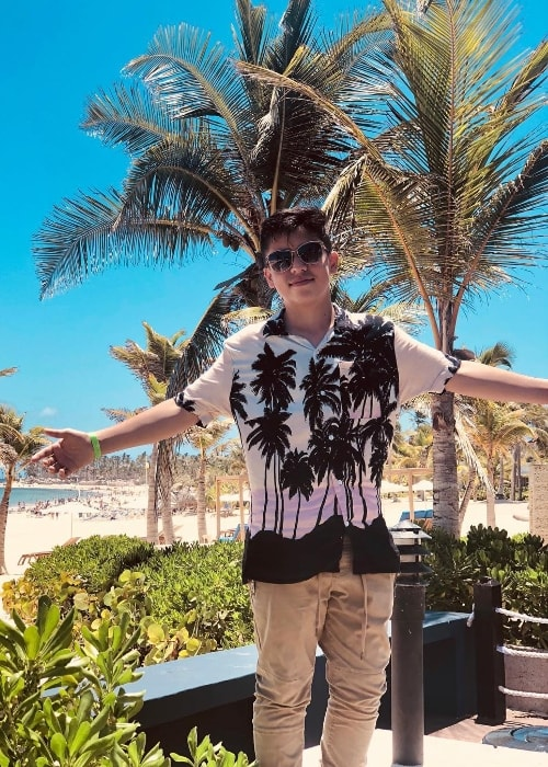 Freddy Pomee as seen while posing for a picture with a stunning backdrop in Punta Cana, Dominican Republic in August 2018