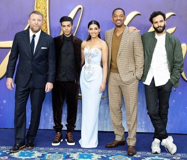 From Left to Right - Guy Ritchie, Mena Massoud, Naomi Scott, Will Smith, and Marwan Kenzari as seen while posing for a picture during an event in London, England, United Kingdom in May 2019