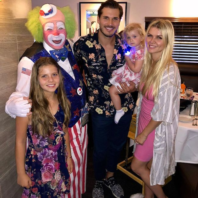 Gleb Savchenko and Elena Samodanova at The Nest with a clown in July 2019