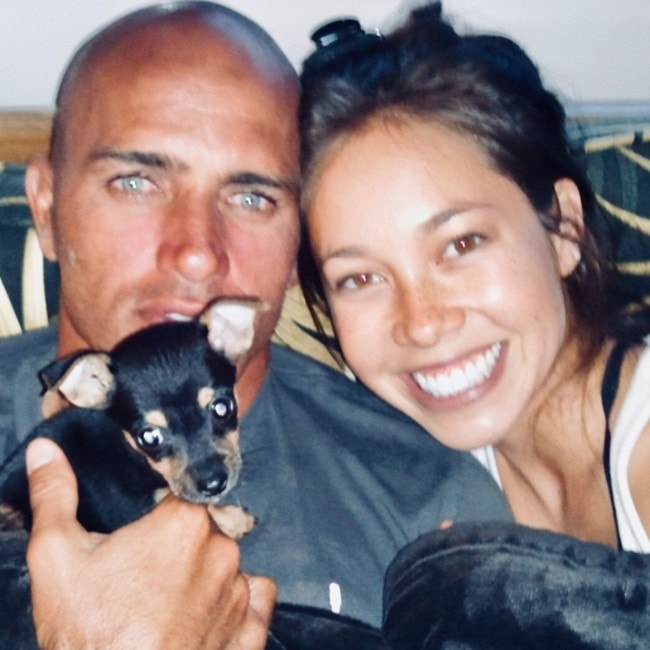 Kelly Slater with his girlfriend Kalani with their puppy as seen in July 2018