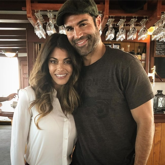 Lindsay Hartley as seen while posing for the camera along with Jordi Vilasuso in Boston, Massachusetts, United States in September 2018