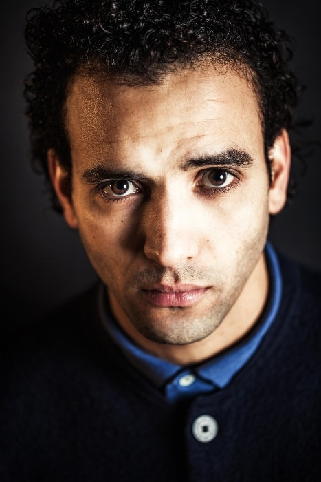 Marwan Kenzari as seen while looking directly at the camera