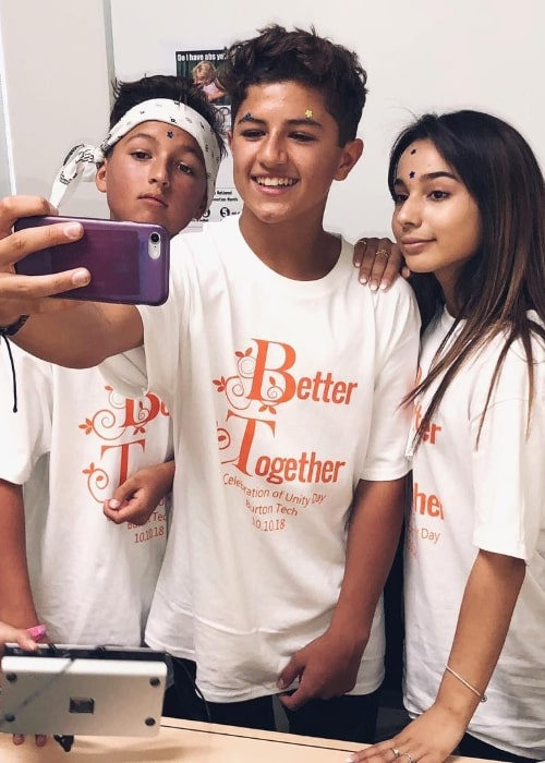 Mason Coutinho as seen while taking a mirror selfie with Angelic (Right) and Julez (Left) in Los Angeles, California, United States in October 2018