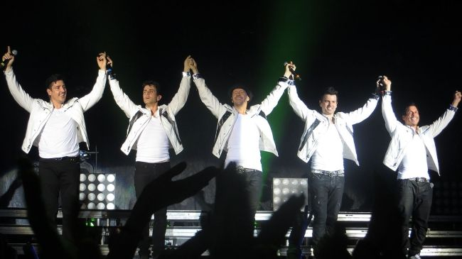 Members of New Kids on the Block performing together at the European tour in 2014