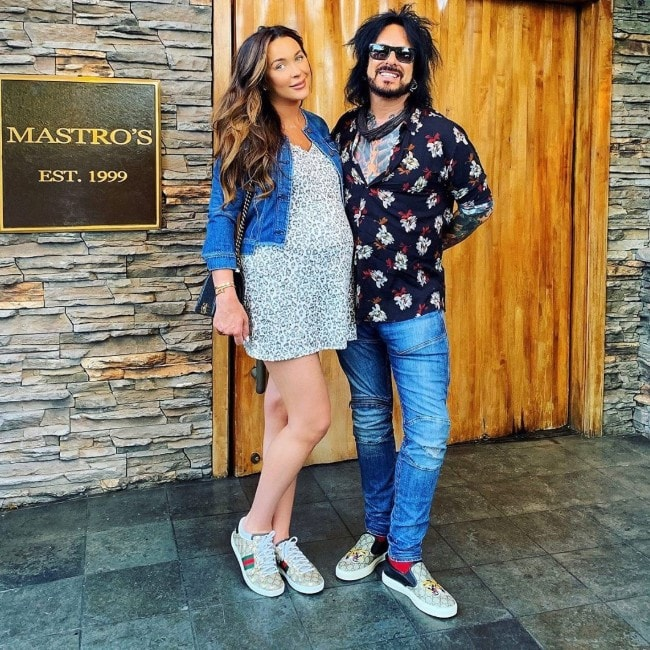 Nikki Sixx with his wife Courtney as seen in July 2019