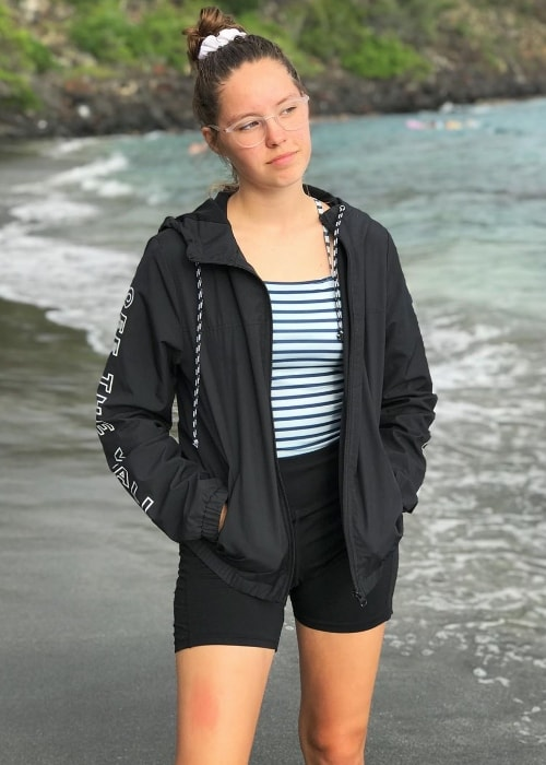Peyton Coffee as seen while posing for a picture while standing by the beach in May 2019