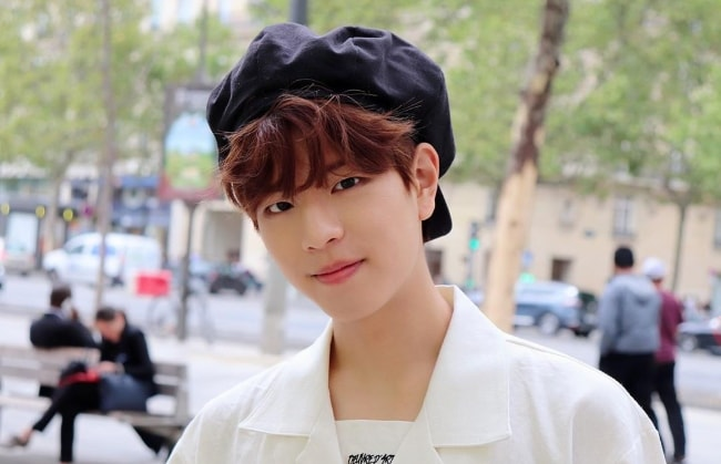Seungmin as seen while posing for a picture in August 2019