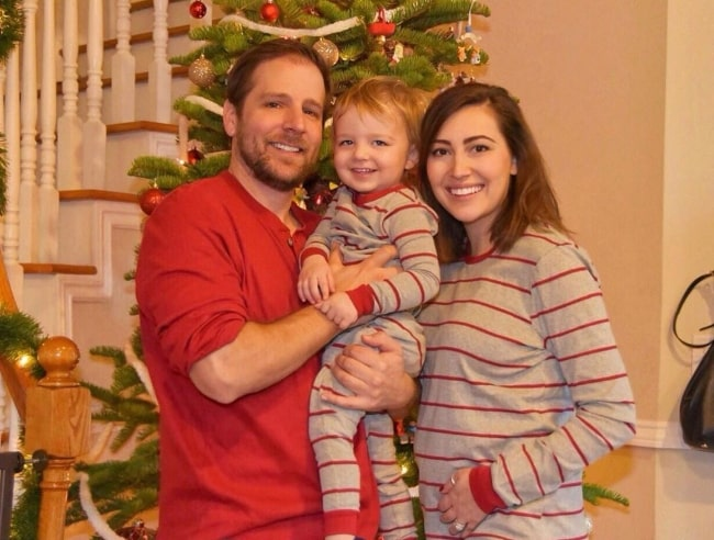 Taylor Dooley as seen while posing for a family Christmas picture along with her husband, Justin Cassotta, and their son in December 2018