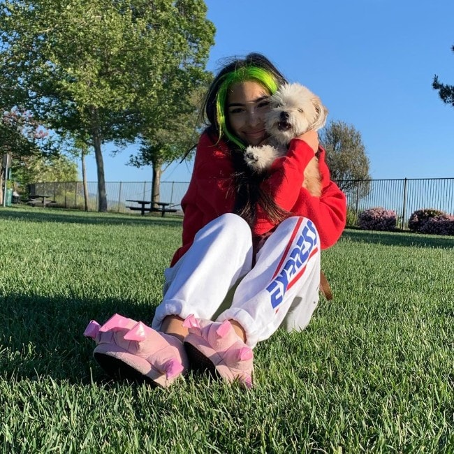 Vereena Sayed with her dog as seen in April 2019