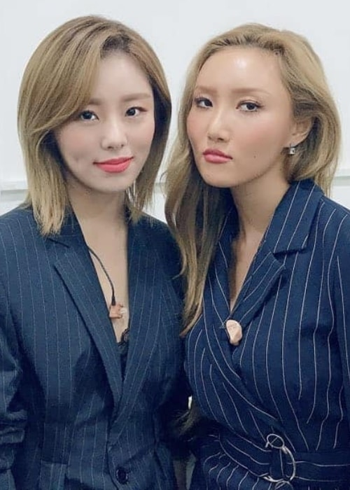 Wheein (Left) as seen while posing for a picture alongside her Mamamoo bandmate, Hwasa, in May 2019