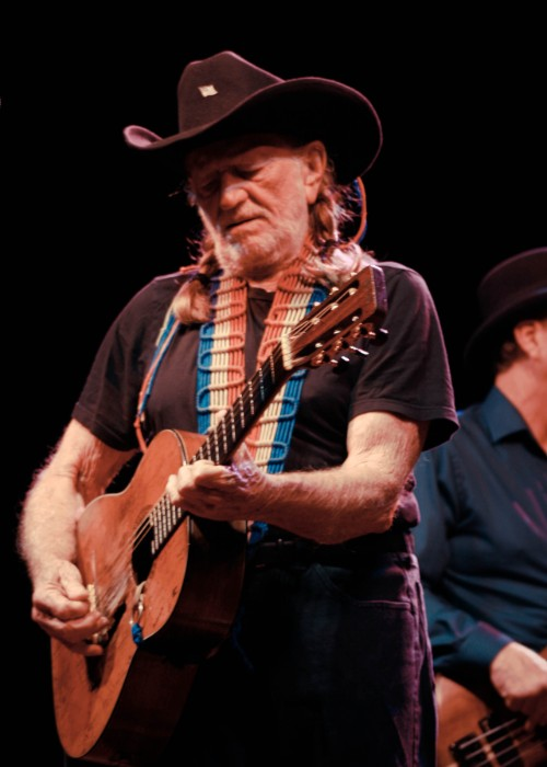 Willie Nelson performing on stage as seen in June 2011